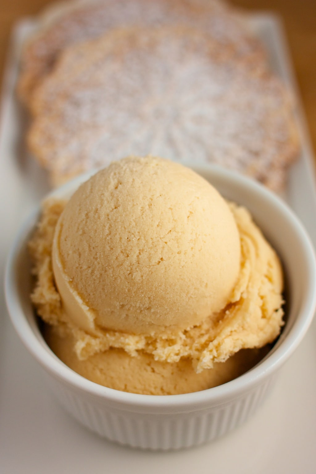 A scoop of salted caramel ice cream with pizzelle cookies