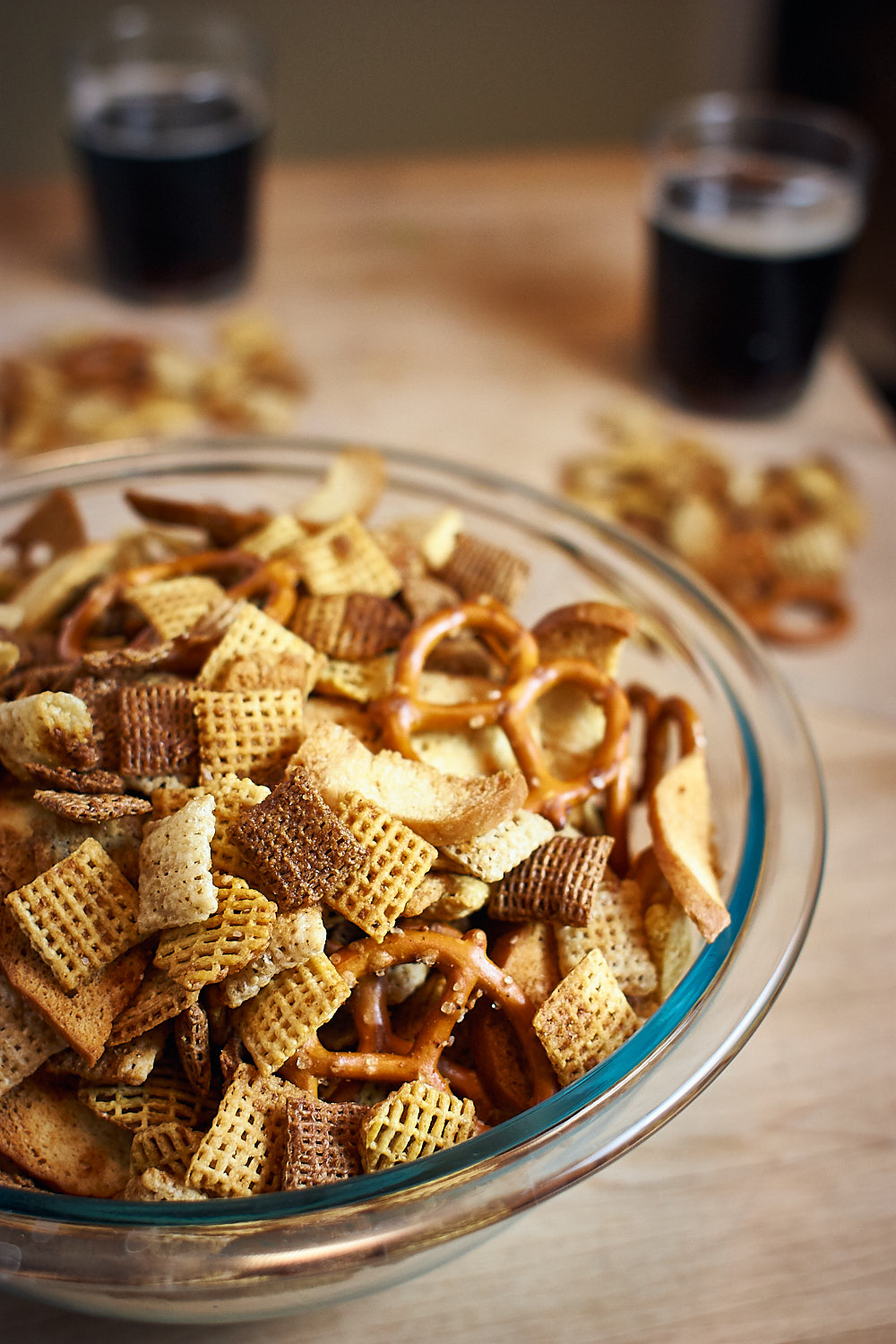 A bowl of dairy-free Chex mix and root beer.