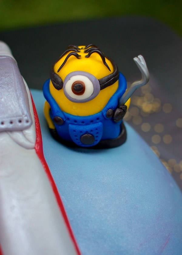 Fondant minion character with a crowbar.