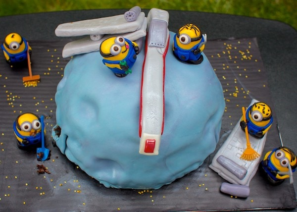 Birthday cake with fondant W-wing fighter and Minions.