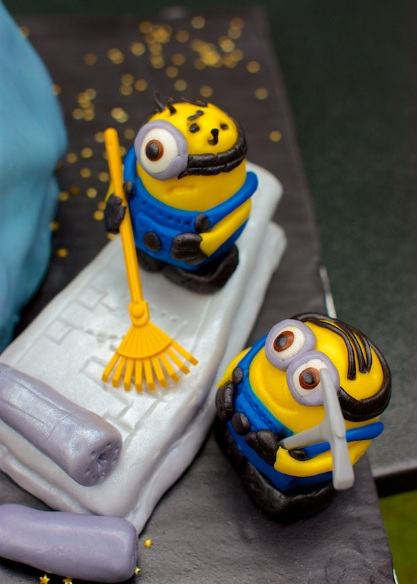 Fondant minion characters on an x-wing fighter wing.