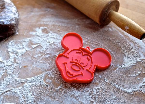 vintage mickey mouse cookie cutter on a cutting board