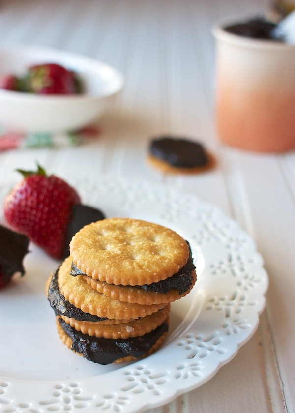 A stack of crackers and oreo cookie butter spread on a plate.