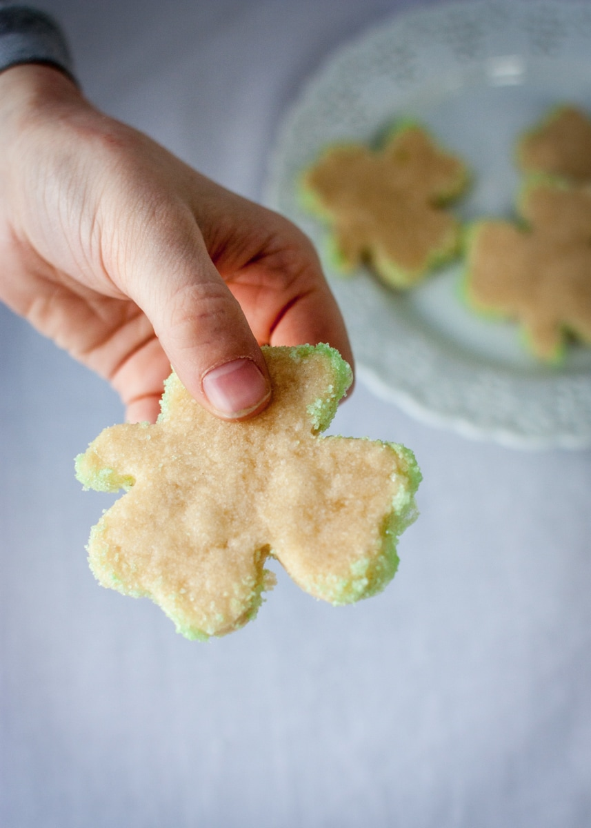 Shamrock shaped sugar cookie with green sparkling sugar