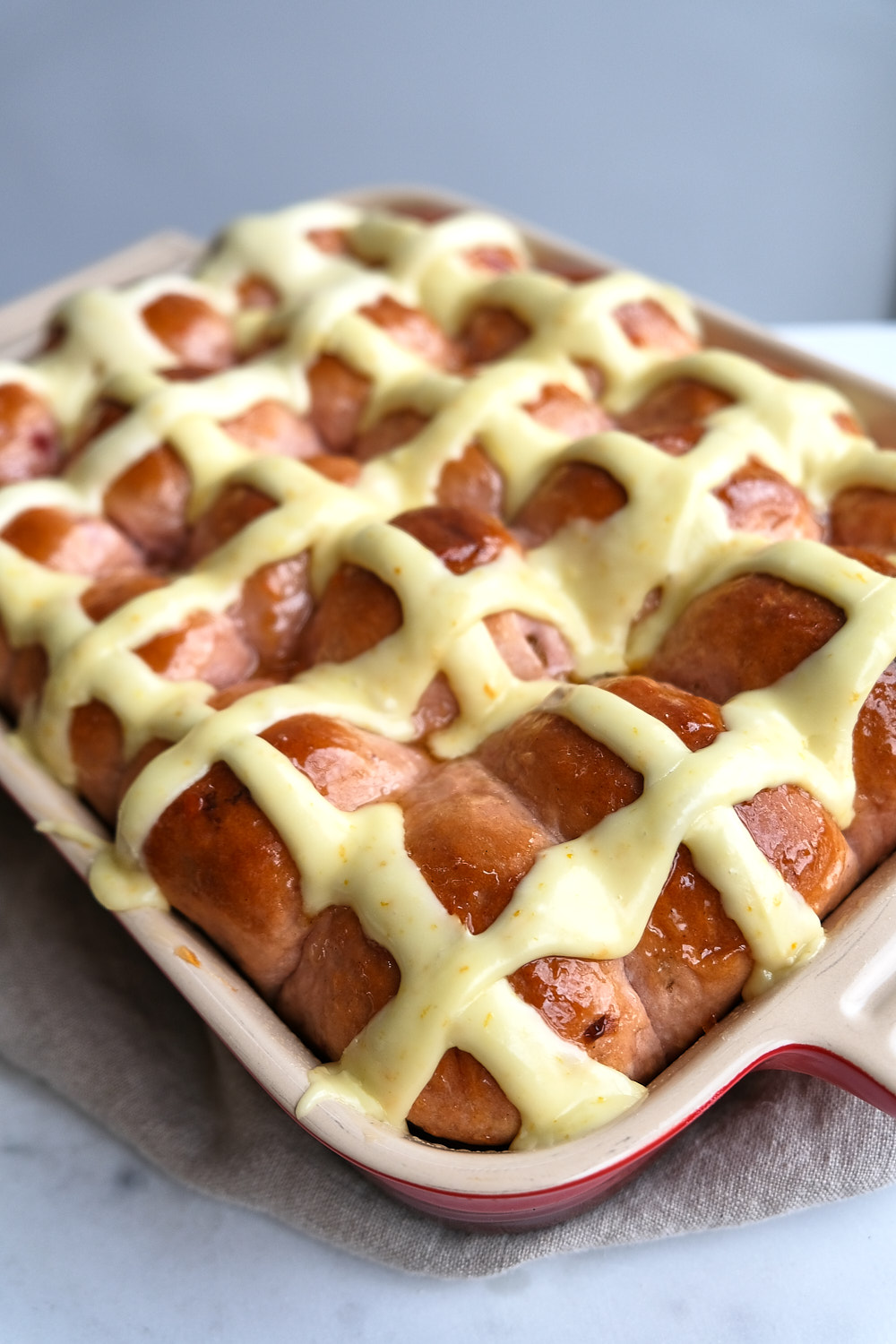 A pan of hot cross buns